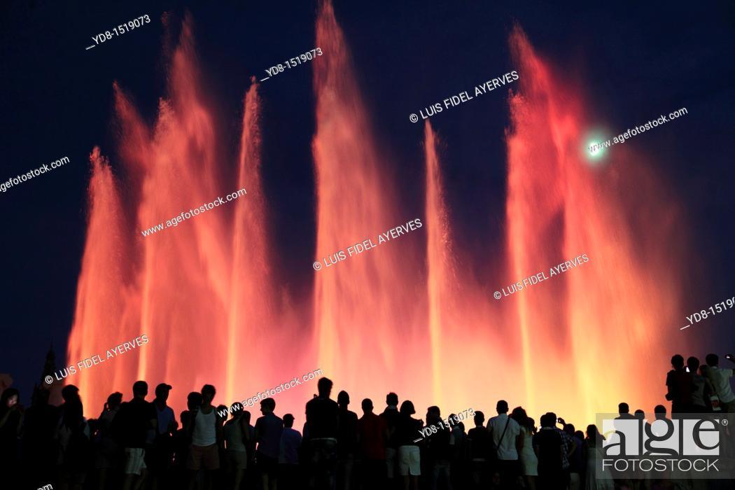 Stock Photo: Tourists enjoying the light show of the Plaza de Espana in Barcelona, Catalonia, Spain.