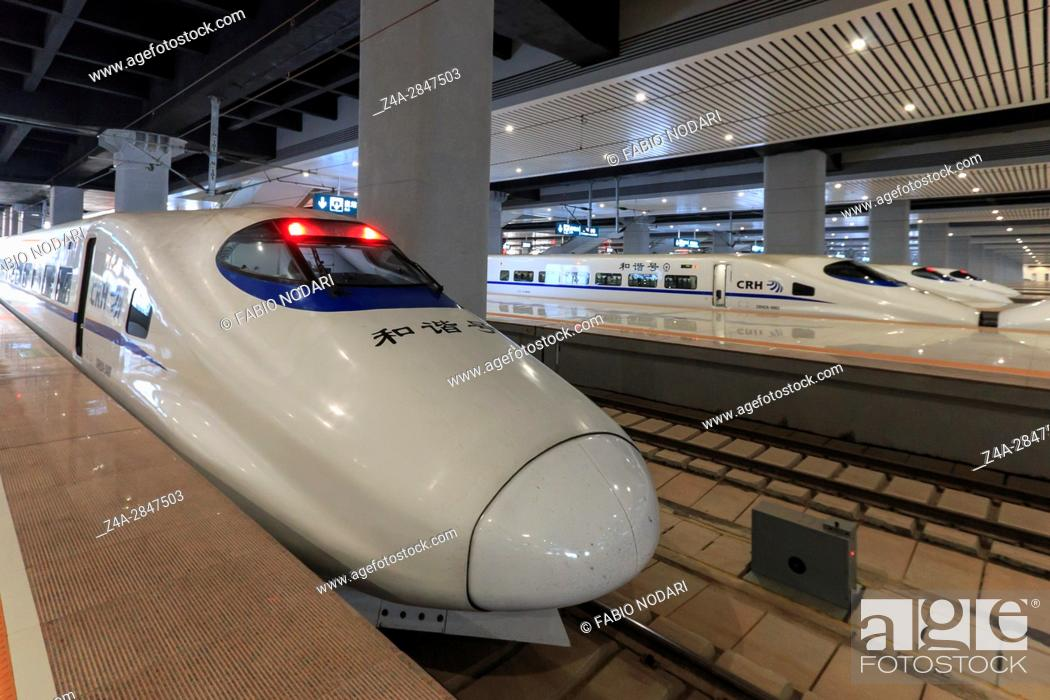 Stock Photo: Kunming, China: Close up of a Chinese fast train inside the newly opened high speed train station in Kunming. The new fast train station links Kunming to.