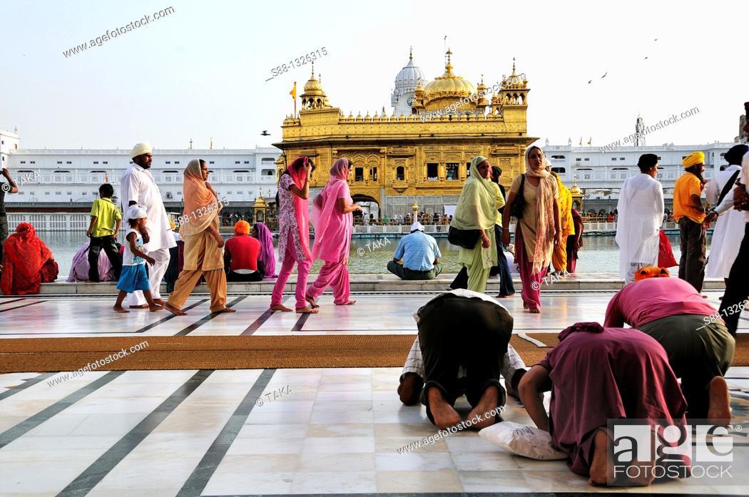 Stock Photo: Sikh pilgrims praying for the God in Golden Temple, Punjab Amritsar India.