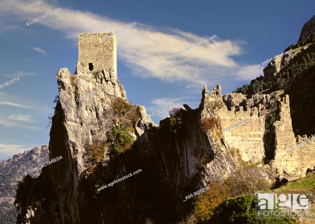 Stock Photo: La Iruela Castle. The Iruela Castle raises upon a rough terrain over a wild rock, cut into two by its two fronts at the Iruela region, Jaenâ.