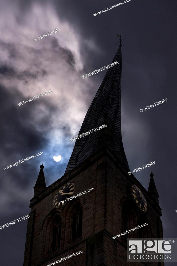 Stock Photo: The partial Solar eclipse over the famous twisted spire of Chesterfield Paris Church in Derbyshire on the 10th of June Featuring: The partial Solar eclipse over.