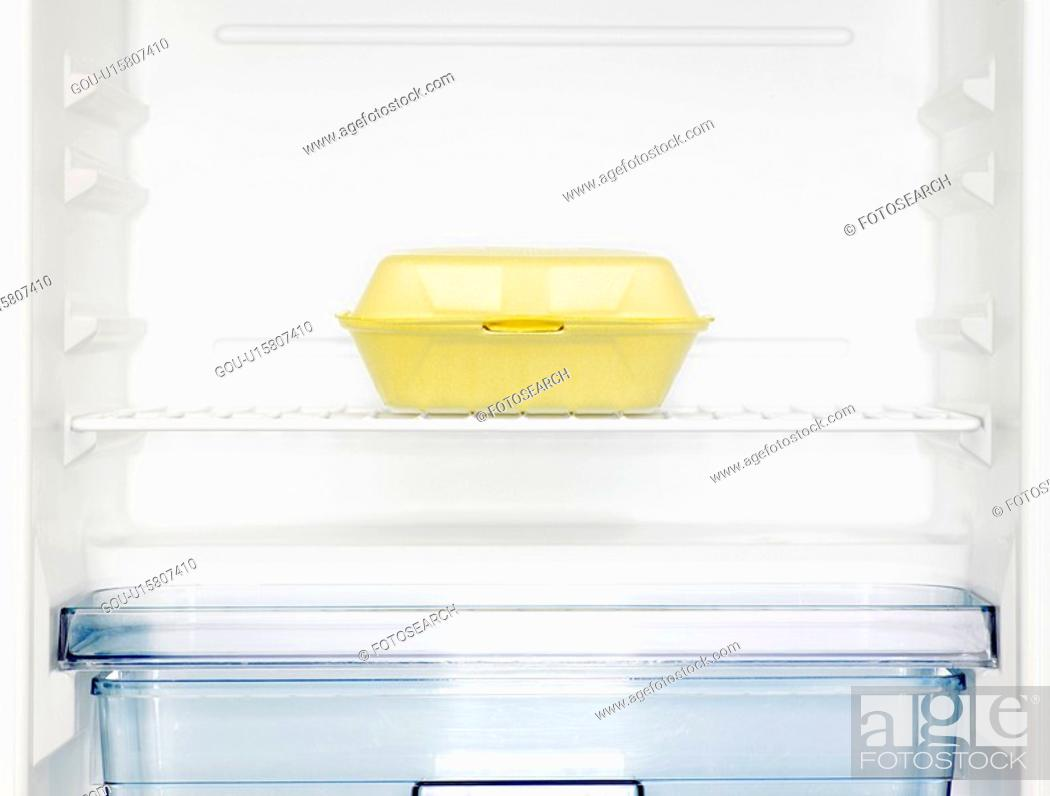 Stock Photo: Take-out box in fridge (close-up).