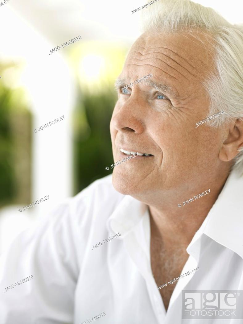 Stock Photo: Senior man looking up and smiling.