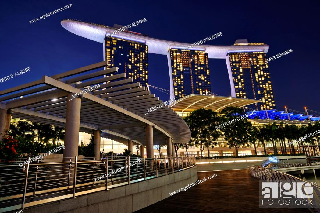 Stock Photo: A walkway in marina Bay. On the background the three tall towers of Marina Bay Sands Hotel. Singapore.