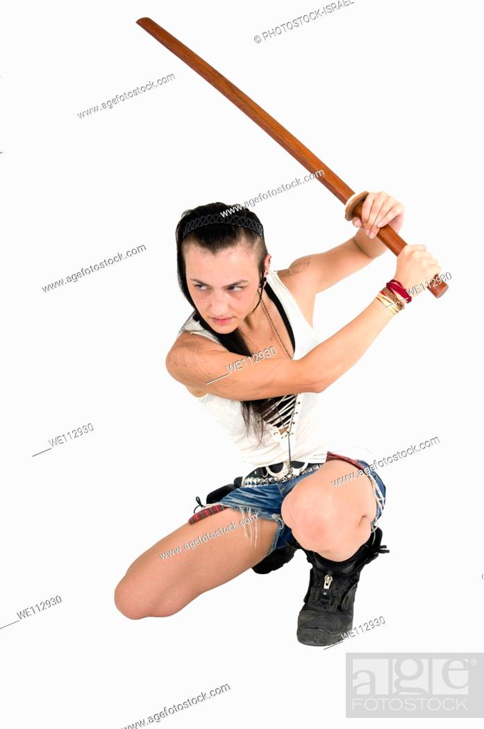 Stock Photo: Young punk teen girl wielding a bokken a wooden Japanese sword used for practice.