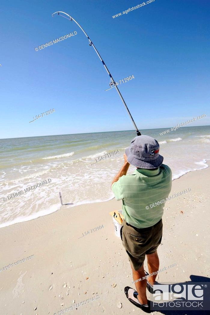 Stock Photo: Senior man fishing for recreation in the Gulf of Mexico at Naples Florida.