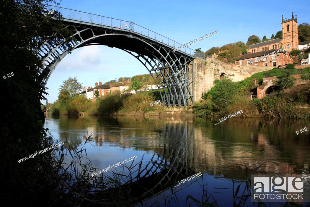 Stock Photo: England, Shropshire, Ironbridge , The Ironbridge Bridge. The world's first cast iron bridge was built over the River Severn by the Darby family firm in 1779.