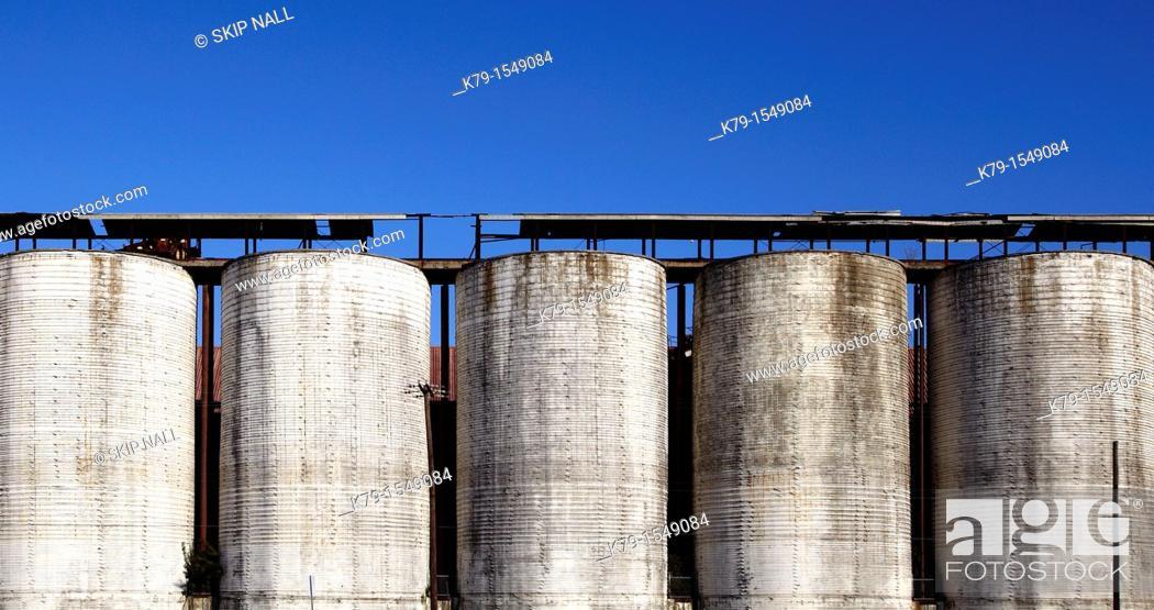 Stock Photo: Row of grain silos.