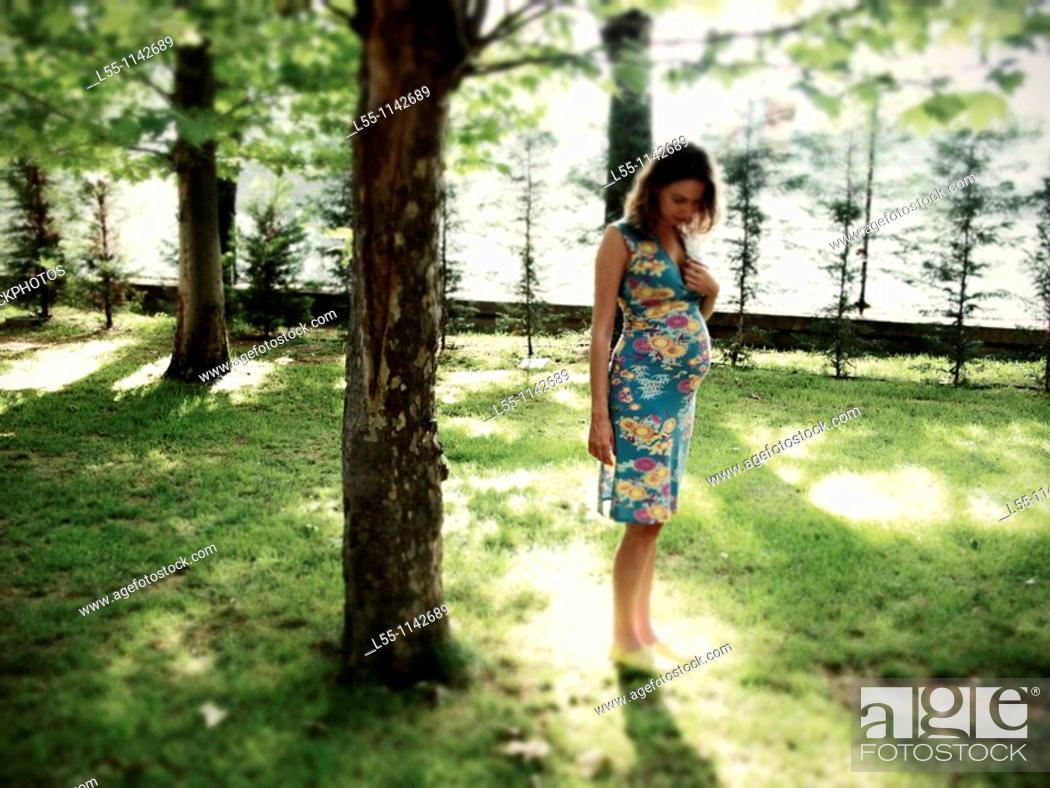 Stock Photo: Pregnant woman in park.