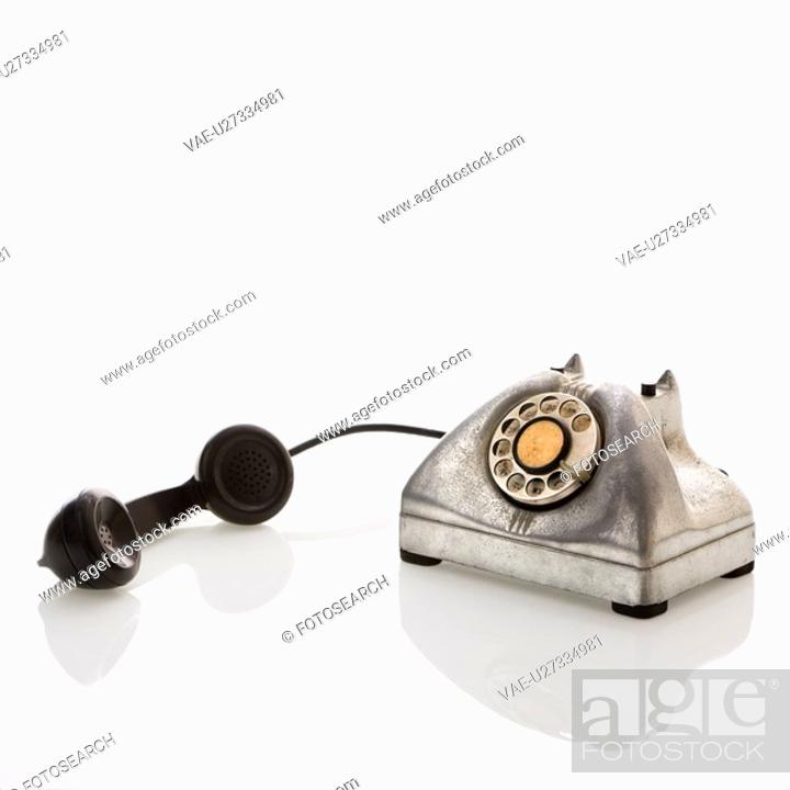 Stock Photo: Rotary telephone with receiver to the side.