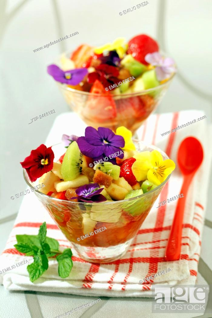 Stock Photo: Fruit salad with quince and petals.