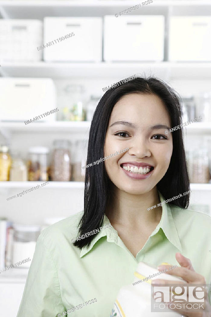 Stock Photo: Portrait of woman in kitchen.