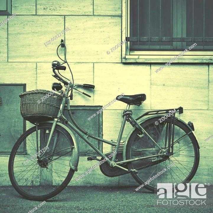Stock Photo: Old bicycle in the street near wall, Rimini, Italy. Vintage style,.