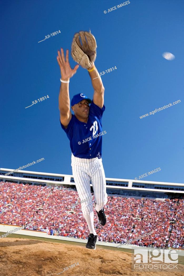 Stock Photo: Baseball player reaching to catch baseball.