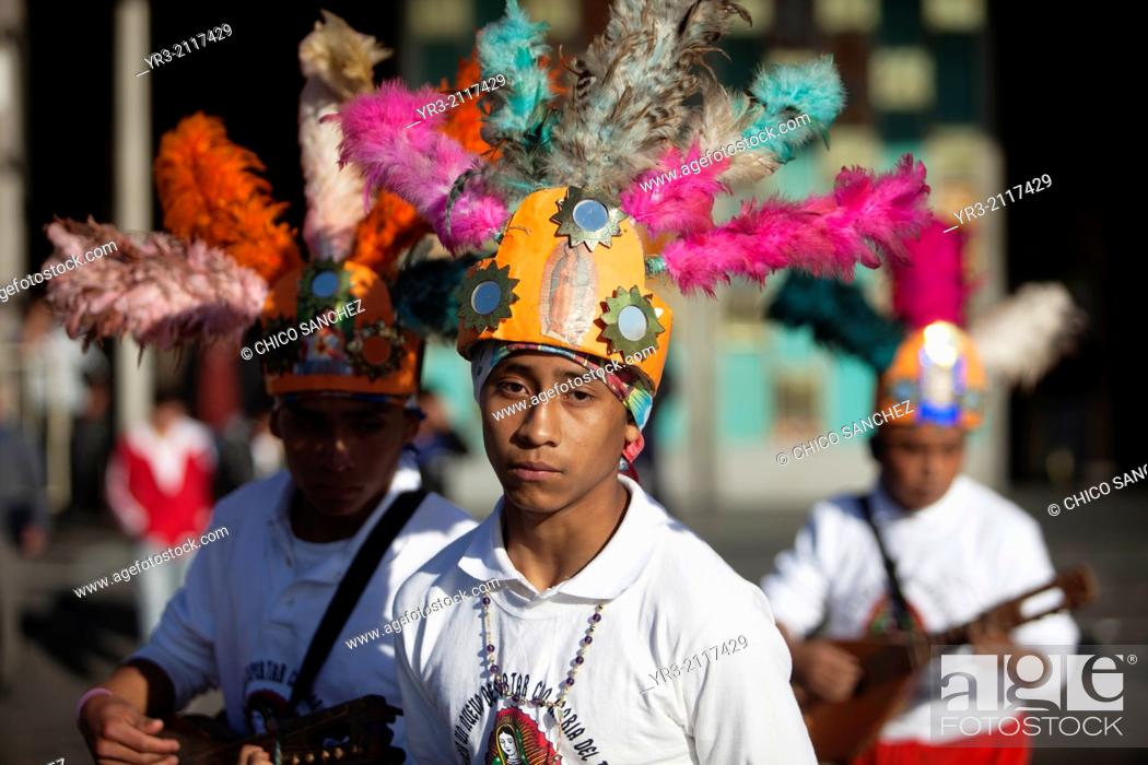 Stock Photo: Concheros from Santiago Centro, Tamzle, San Luis Potosí, performs at the pilgrimage to Our Lady of Guadalupe Basilica in Mexico City, Mexico, December 10, 2013.