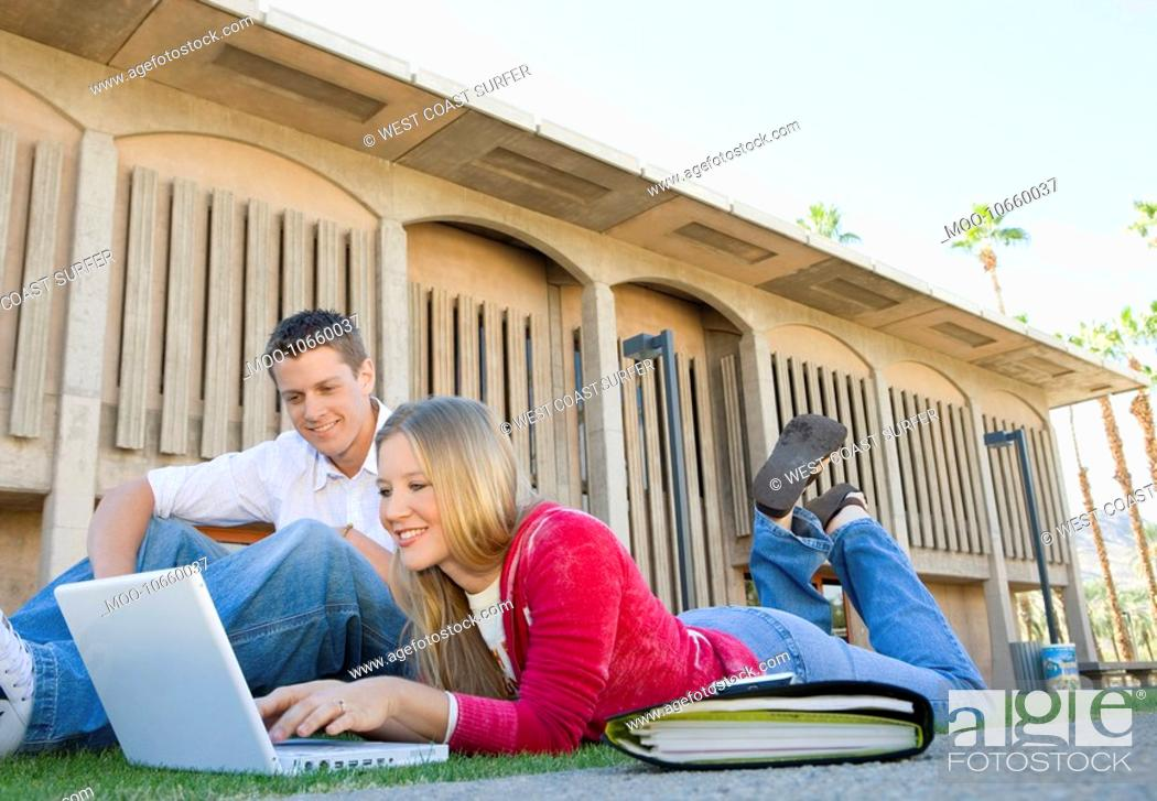 Stock Photo: Two students using laptop outdoors.