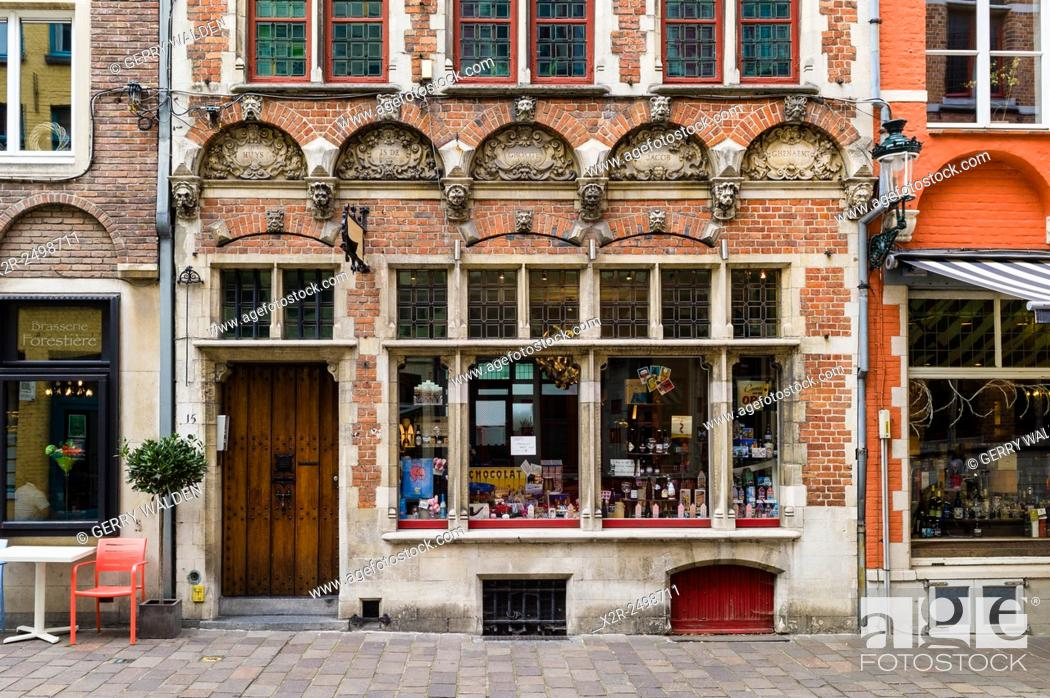 Stock Photo: A typical historic store front in Brugge, Belgium. Situated on Acadamiestraat in the old town, this front was restored in the 19th century.
