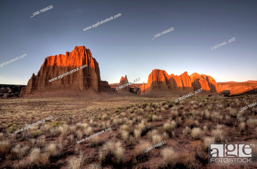 Stock Photo: The morning sun brightens up the landscape at Cathedral Valley at Capital Reef National Park.