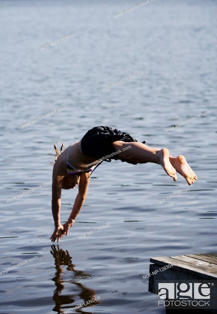 Stock Photo: Young woman diving into water.