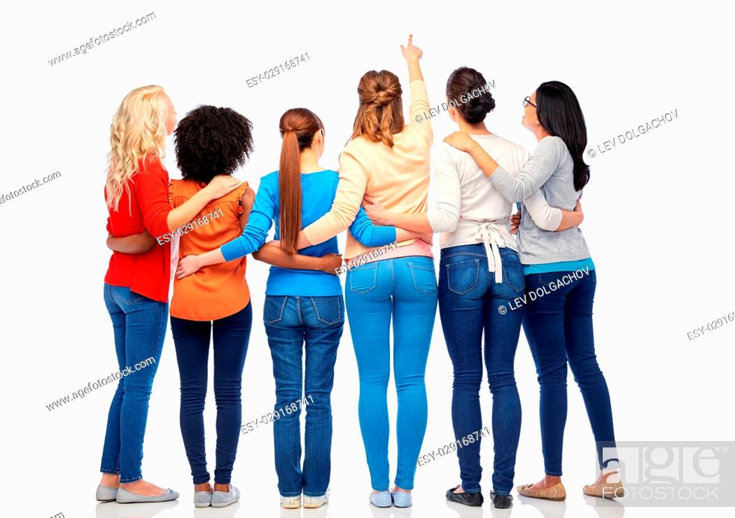 Stock Photo: diversity, race, ethnicity and people concept - international group of happy smiling different women over white pointing finger at something.