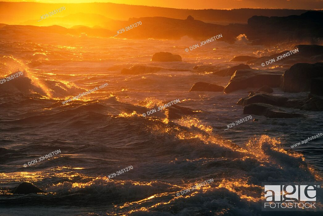 Stock Photo: Heavy surf crashing on rocks at Margarets Bay near sunset, Peggys Cove, Scotia, Canada.