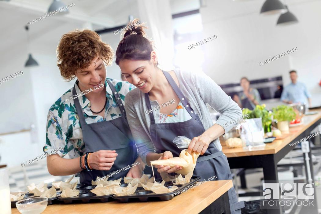 Stock Photo: Couple enjoying cooking class in kitchen.