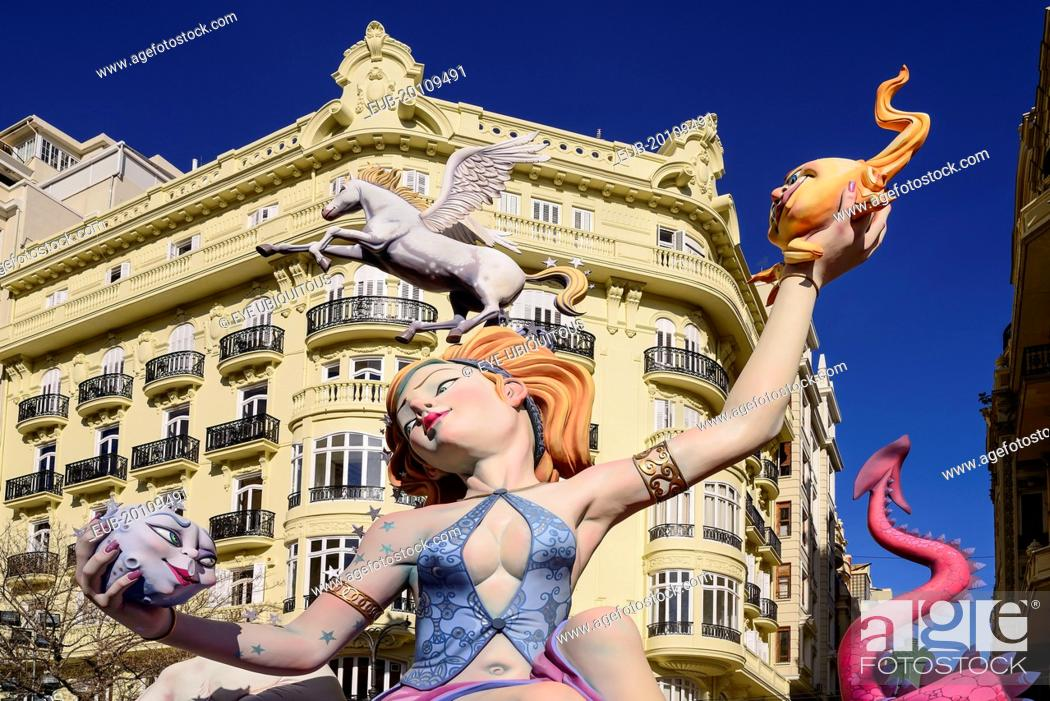 Stock Photo: Female Papier Mache figure with a horse on her head in the street during Las Fallas festival.