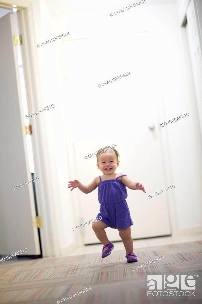Stock Photo: Toddler girl learning to walk.