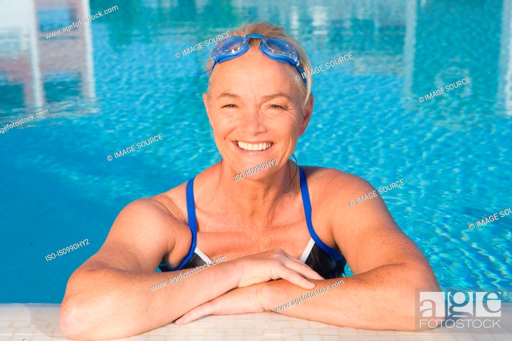 Stock Photo: Mature woman in swimming pool.