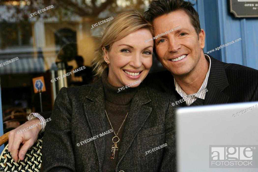 Stock Photo: Mature couple looking at camera.