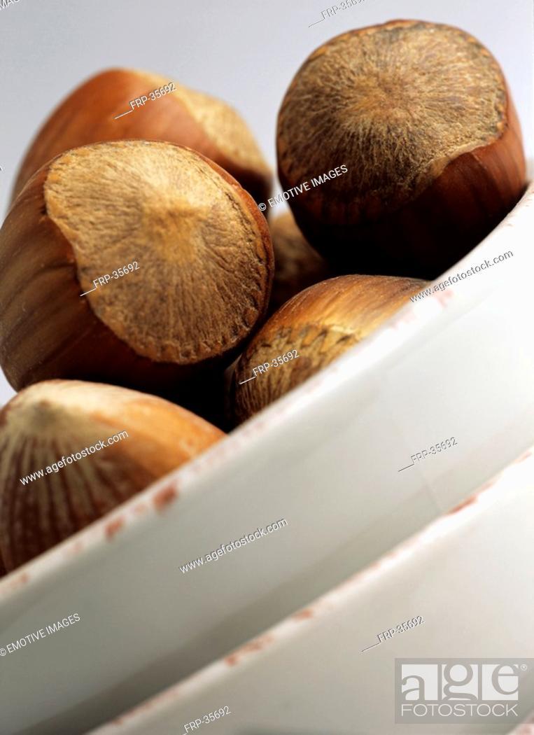 Stock Photo: clos-up hazelnuts.