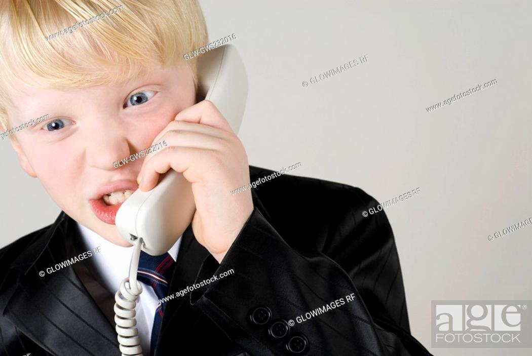 Stock Photo: Close-up of a boy talking on the telephone.
