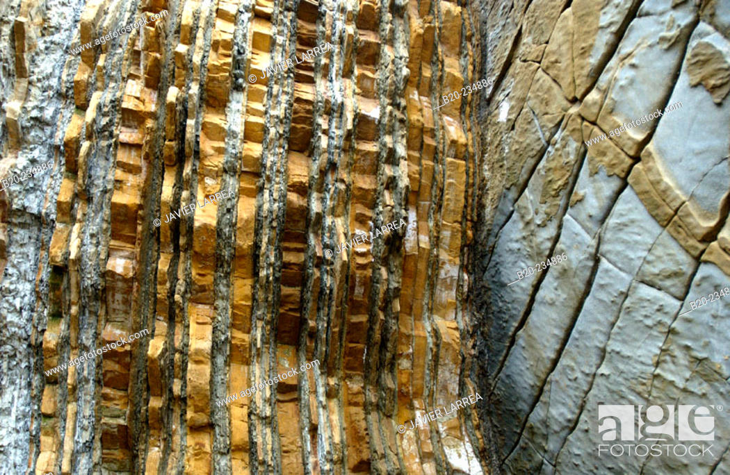 Stock Photo: Rock, geological formations at La Concha bay. San Sebastián. Spain.