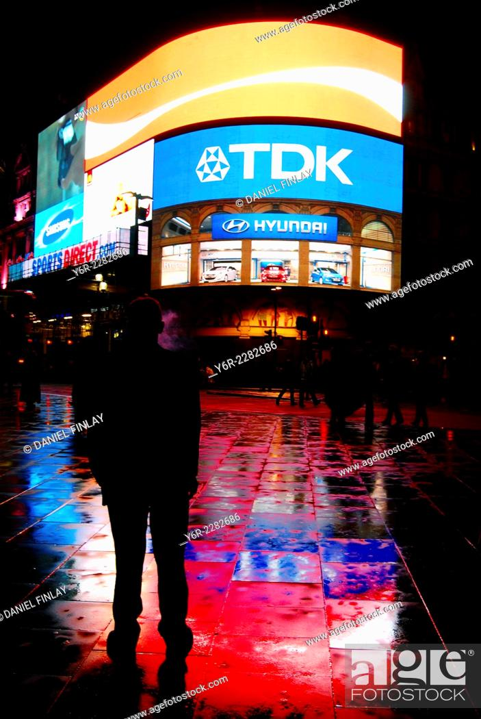 Stock Photo: Piccadilly Circus, London, England, at night, after rain.
