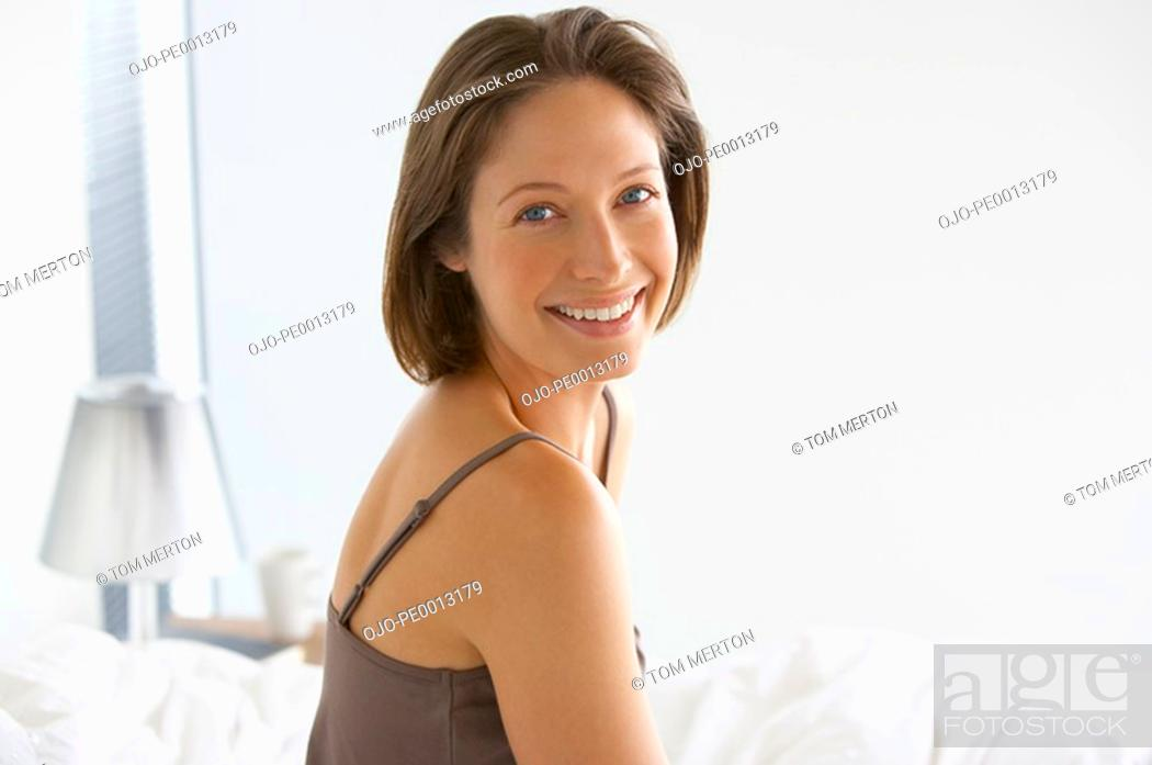Stock Photo: Woman indoors smiling.