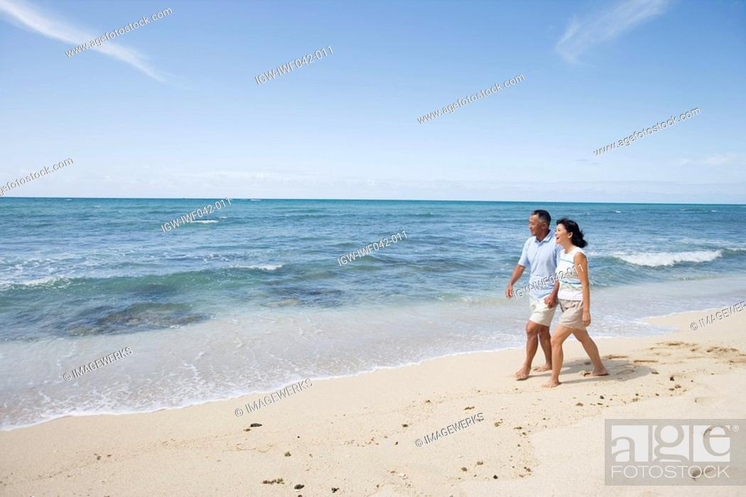 Stock Photo: A couple walking at beach.