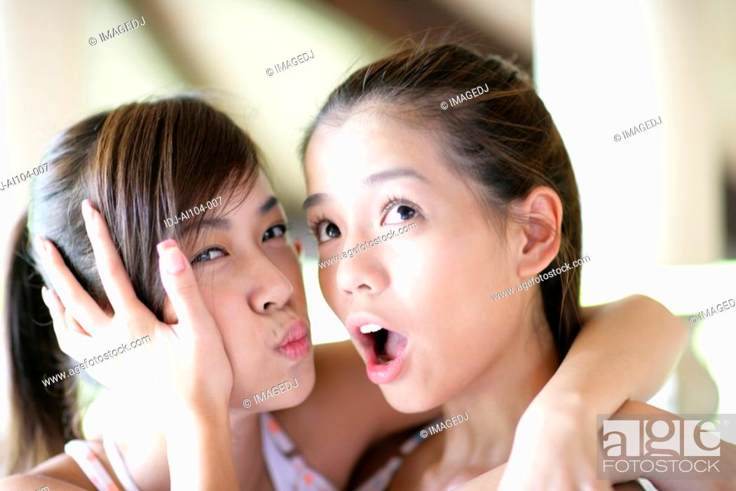 Stock Photo: Young women with surprised expression.
