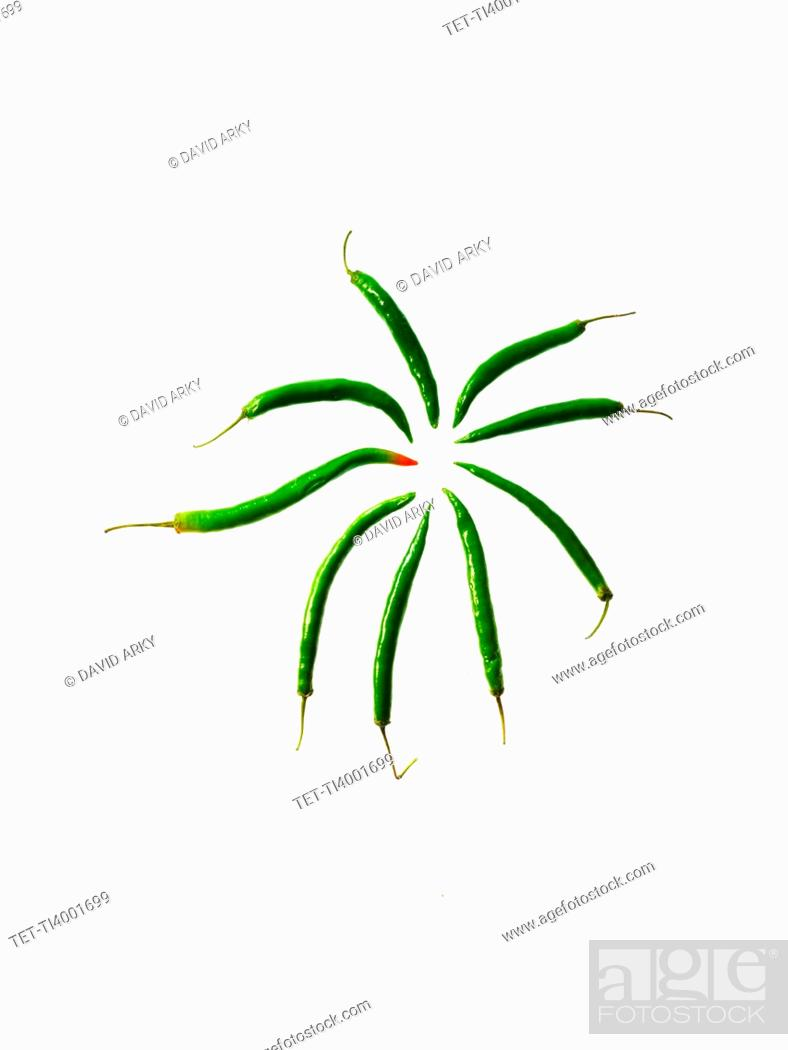 Stock Photo: Studio shot of Green Chili Peppers on white background.