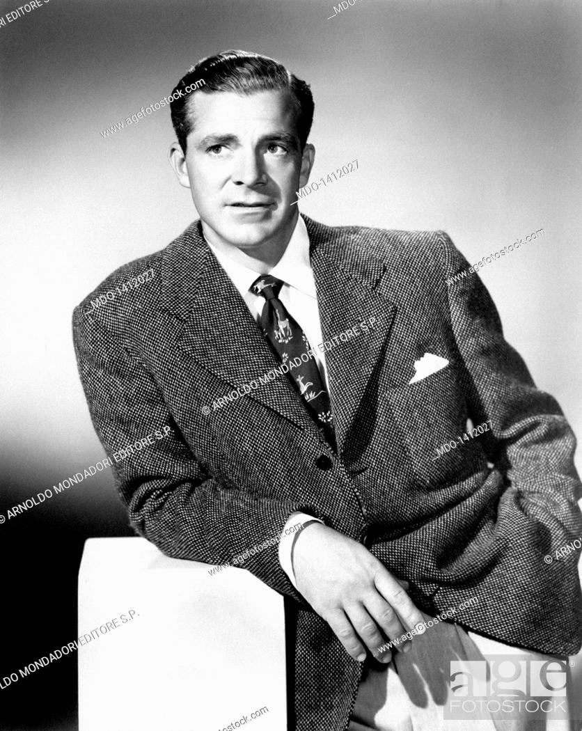 Dana Andrews in a casual pose  The actor Dana Andrews leans