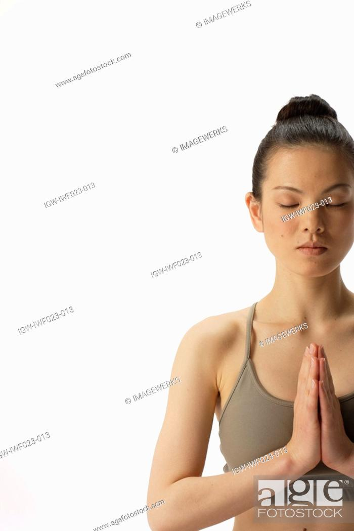 Stock Photo: Close-up of a young woman meditating.