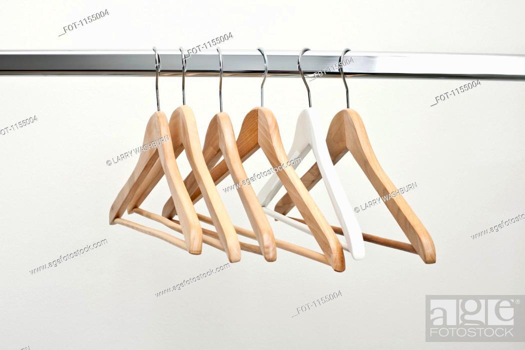 Stock Photo: Row of coat hangers.