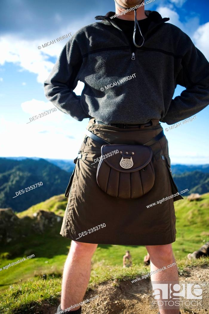 Stock Photo: A Man Wearing A Skirt And Pouch Around His Waist, Whanganui National Park; Whakahoro, New Zealand.