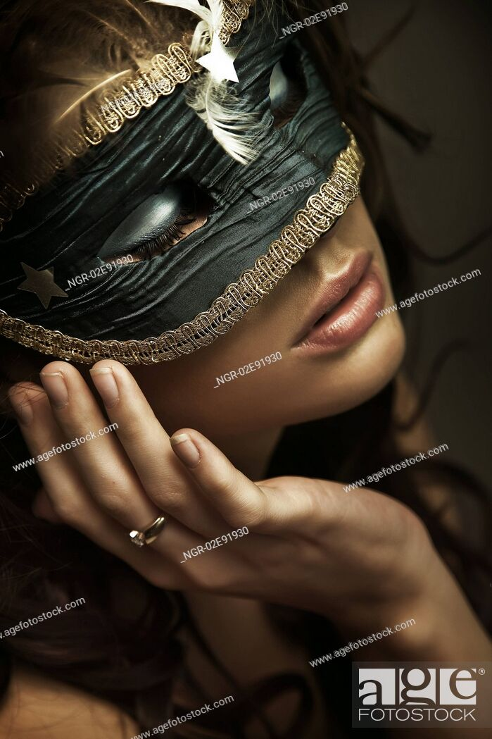 Stock Photo: Portrait of a young woman wearing mask.