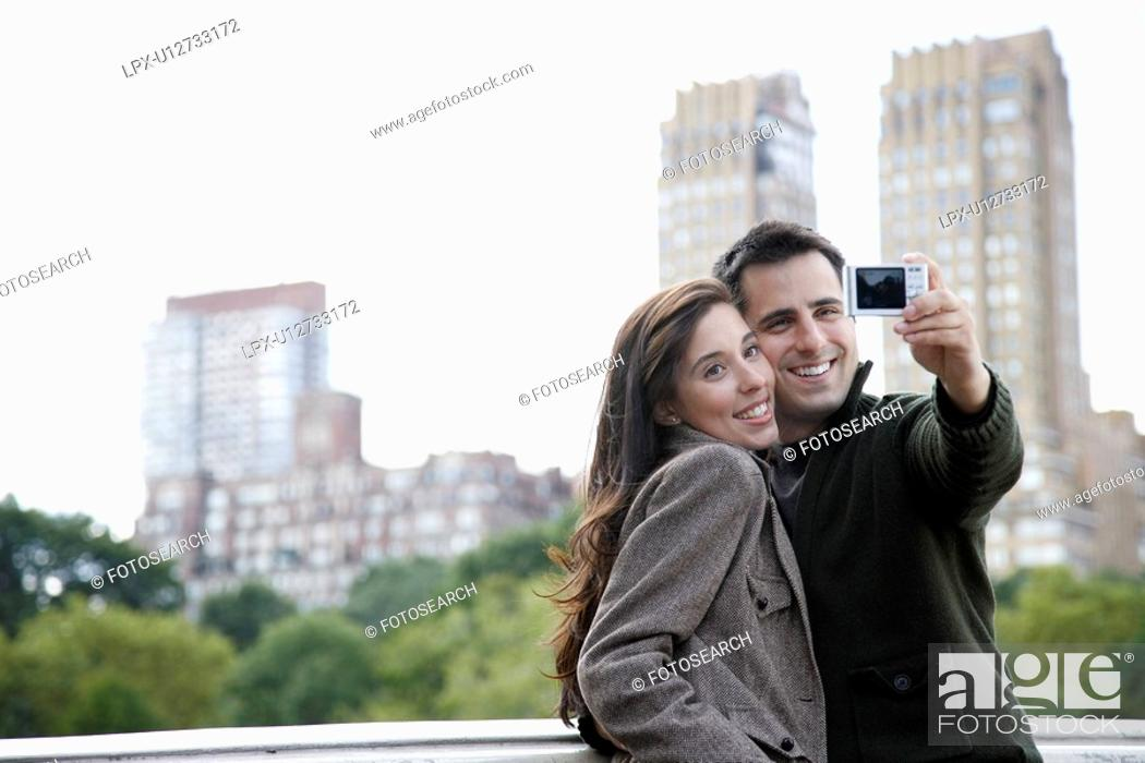 Stock Photo: Couple photographing themselves.