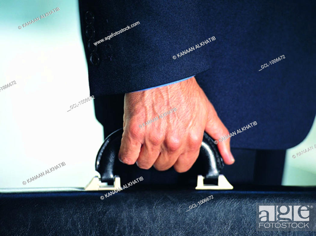 Stock Photo: Businessman holding a briefcase.