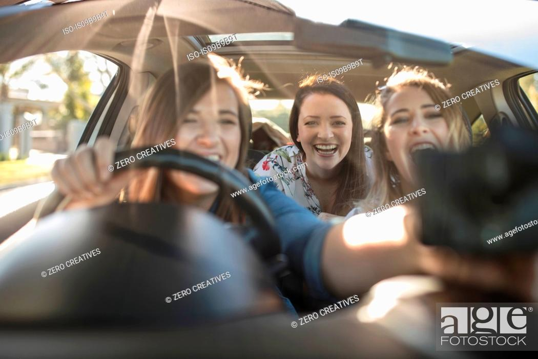 Three Young Women In Car Driver Adjusting Sat Nav On Window Stock Photo Picture And Royalty Free Image Pic Iso Is09b9b9t Agefotostock