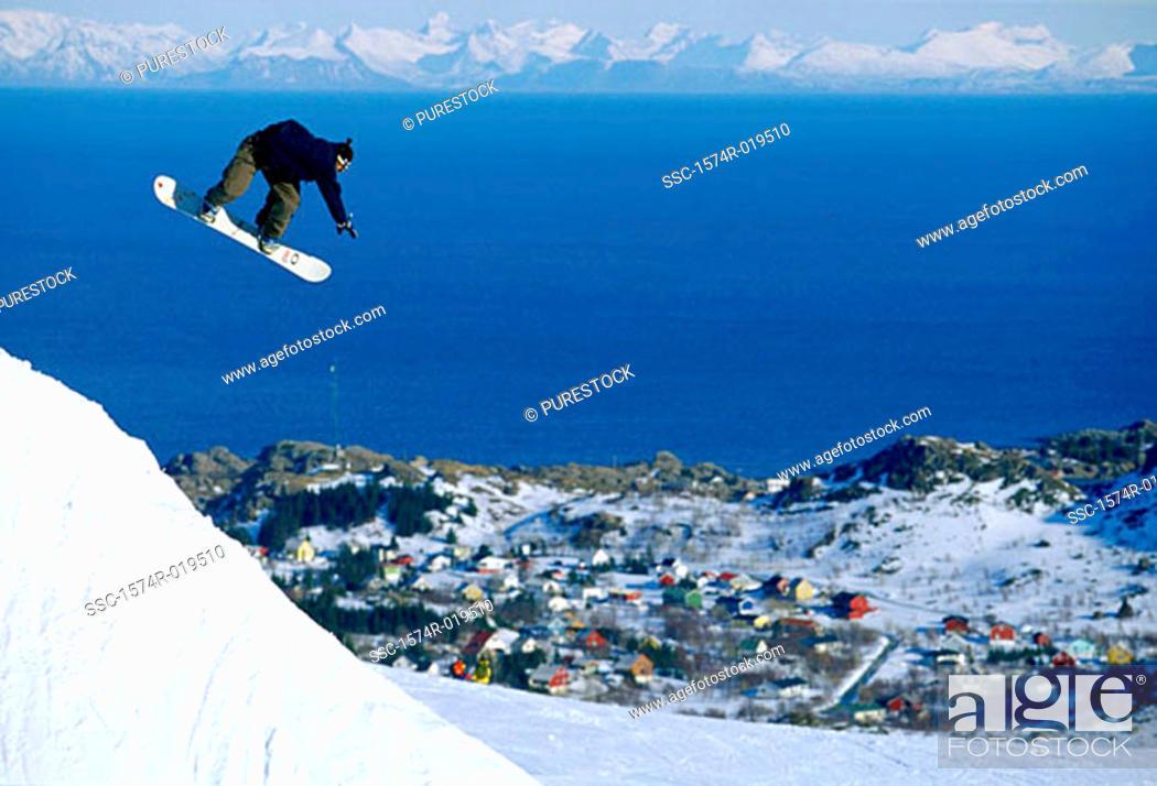 Stock Photo: Person snowboarding downhill.