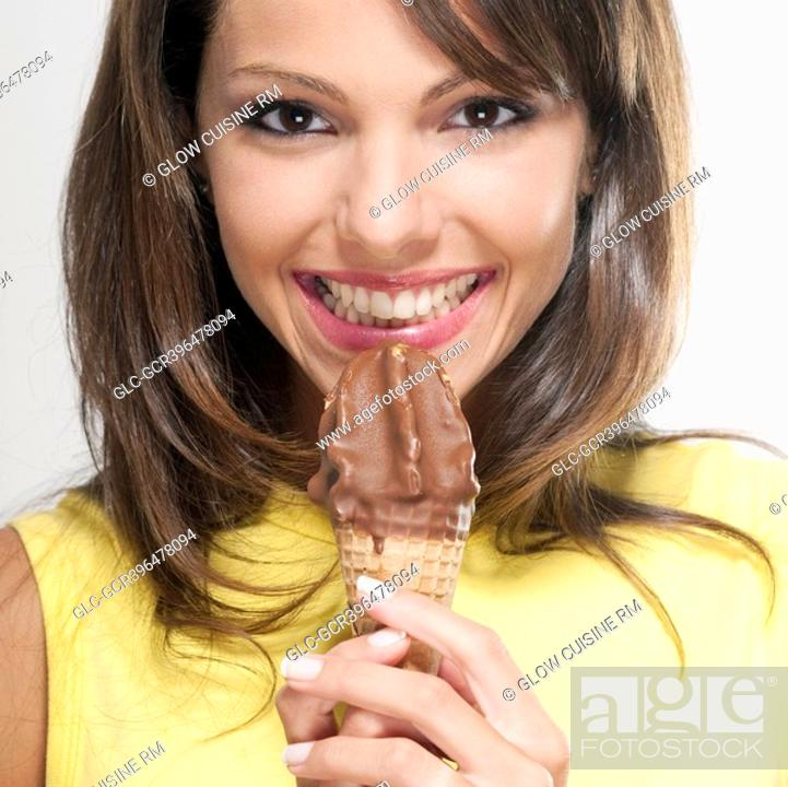 Stock Photo: Portrait of a woman holding an ice cream cone.