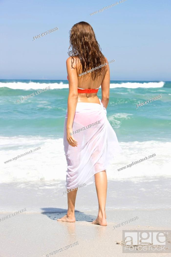 Stock Photo: Woman standing on the beach.