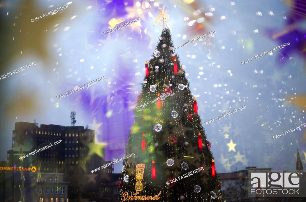 Stock Photo: The according to the organisers biggest Christmas tree in the world illuminates the Christmas market in Dortmund, Germany, 30 November 2017.